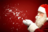Santa Claus blowing snow — Stock Photo