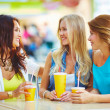 Happy girls chatting while having drink — Stock Photo