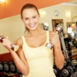 Girl with dumbbells — Stock Photo