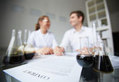 Oil and contract signed by chemists — Stock Photo