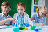 Children working with chemical liquids — Stockfoto