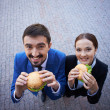 Stock Photo: Colleagues eating sandwiches