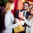 Stock Photo: Colleagues giving presents