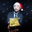 Businessman offering Christmas gift — Stock Photo #38905103
