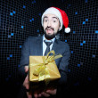 Businessman offering Christmas gift — Stock Photo