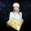 Businesswoman holding Christmas gift — Stock Photo #38905117