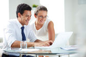 Businesspeople with laptop — Stock Photo