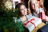 Females giving xmas presents — Stock Photo