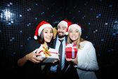 Joyful colleagues in Santa caps — Stock Photo