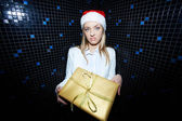 Businesswoman holding Christmas gift — Stock Photo