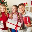 Family with giftboxes — Stock Photo #38916943