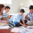 Family drawing together at home — Stok fotoğraf