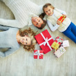 Family with giftboxes — Stock Photo #38917021