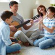 Family playing musical instruments — Stock Photo #38917043
