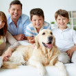 Family at home with dog — Stock Photo