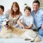 Happy family with dog — Stock Photo
