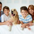 Happy family with dog — Stock Photo