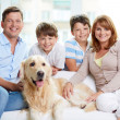 Family with their pet — Stock Photo