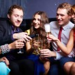 Friends with flutes of champagne — Stock Photo