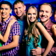 Girls and guys at party — Stock Photo