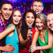 People in karaoke party — Stock Photo