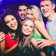 Group of friends at party — Stock Photo