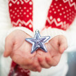 Holding star in hands — Stock Photo #38918455