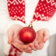Stock Photo: Toy ball on female hands