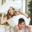 Couple playing with pillows — Stock Photo #38919517