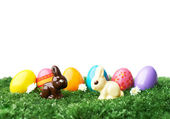 Easter egg and chocolate rabbits — Stock Photo