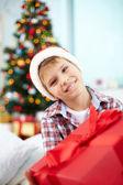 Boy with Christmas present — Stock Photo