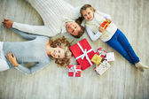 Family with giftboxes — Stock Photo