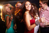 Cheerful girl with champagne flute — Stock Photo