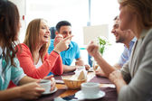 Friends chatting in cafe — Stock Photo