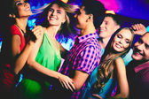 Friends dancing at disco — Stock Photo