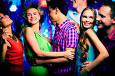 Friends at disco — Stock Photo