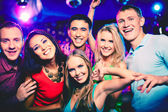 Cheerful friends at party — Stock Photo