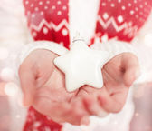 Christmas star in hands — Stock Photo