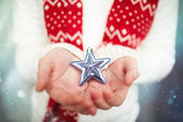 Holding star in hands — Stock Photo
