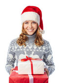 Girl in Santa cap holding giftbox — Stock Photo