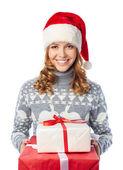 Girl in Santa cap holding giftbox — Stock Photo