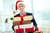 Businessman with presents — Stock Photo
