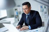 Businessman typing — Stock Photo