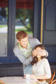 Man closing his girlfriend eyes — Stock Photo