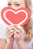 Woman holding paper heart — Stock Photo