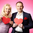 Couple with red paper hearts — Stock Photo