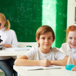 Stock Photo: Schoolchildren at lesson