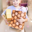 Stock Photo: Child holding paperbag and giftbox