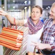 Couple choosing gifts — Stock Photo