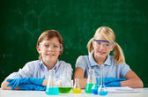 Children working with chemical liquids — ストック写真